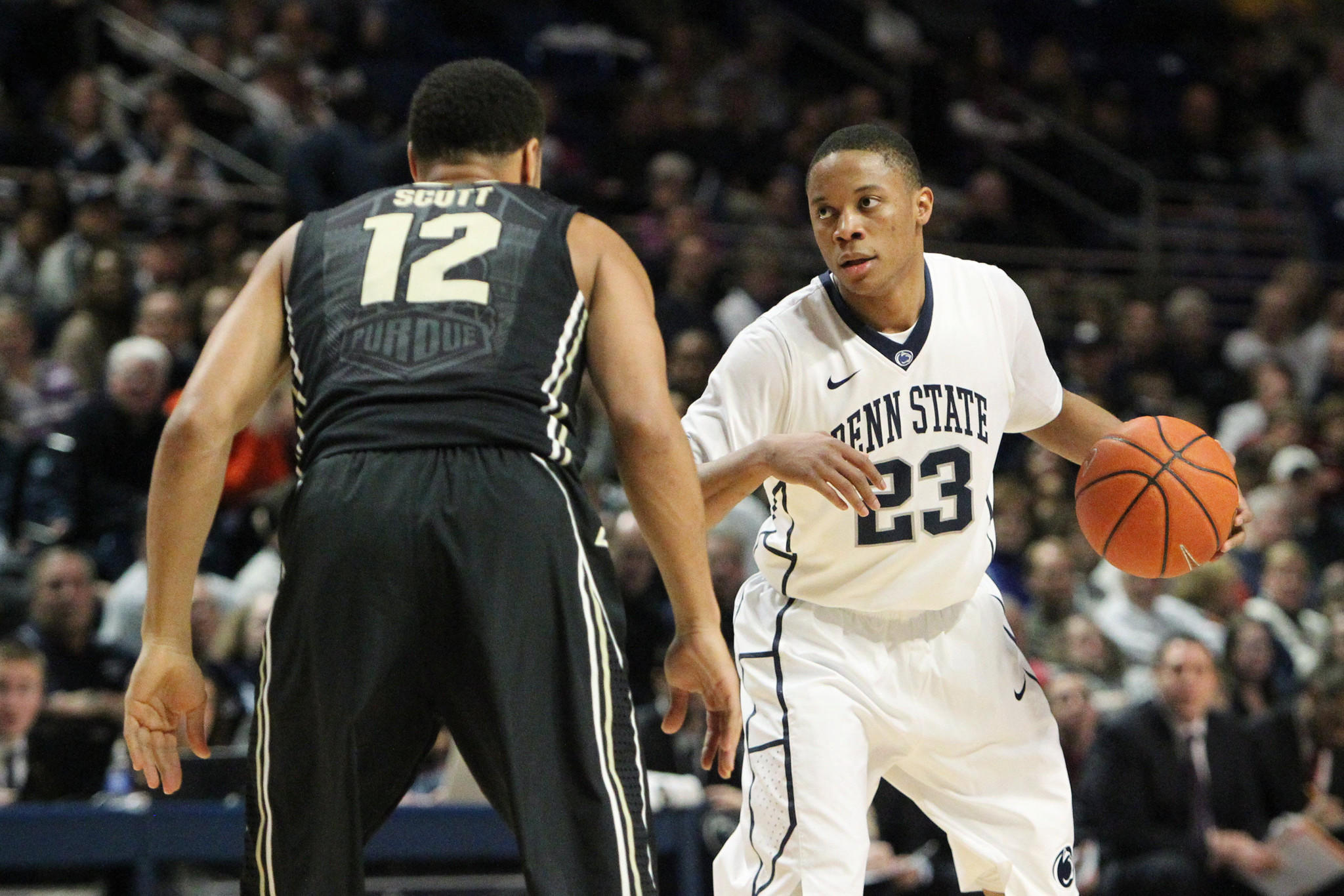 Penn State guard Tim Frazier signals as Purdue guard Bryson Scott awaits.