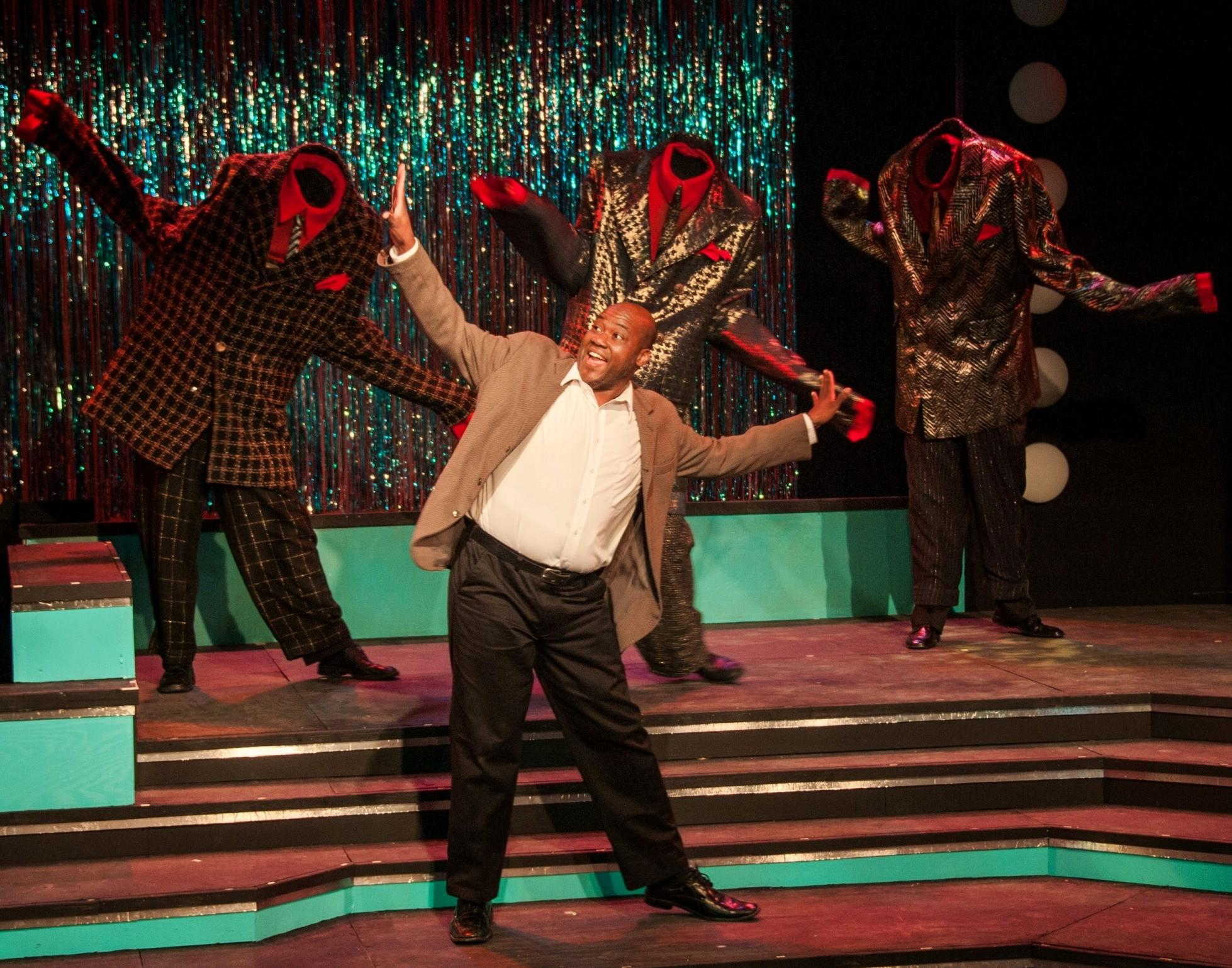 "Mani Cadet dances with ""The Big Suits"" during the ""Shopping for Clothes"" number in ""Smokey Joe's Cafe."""