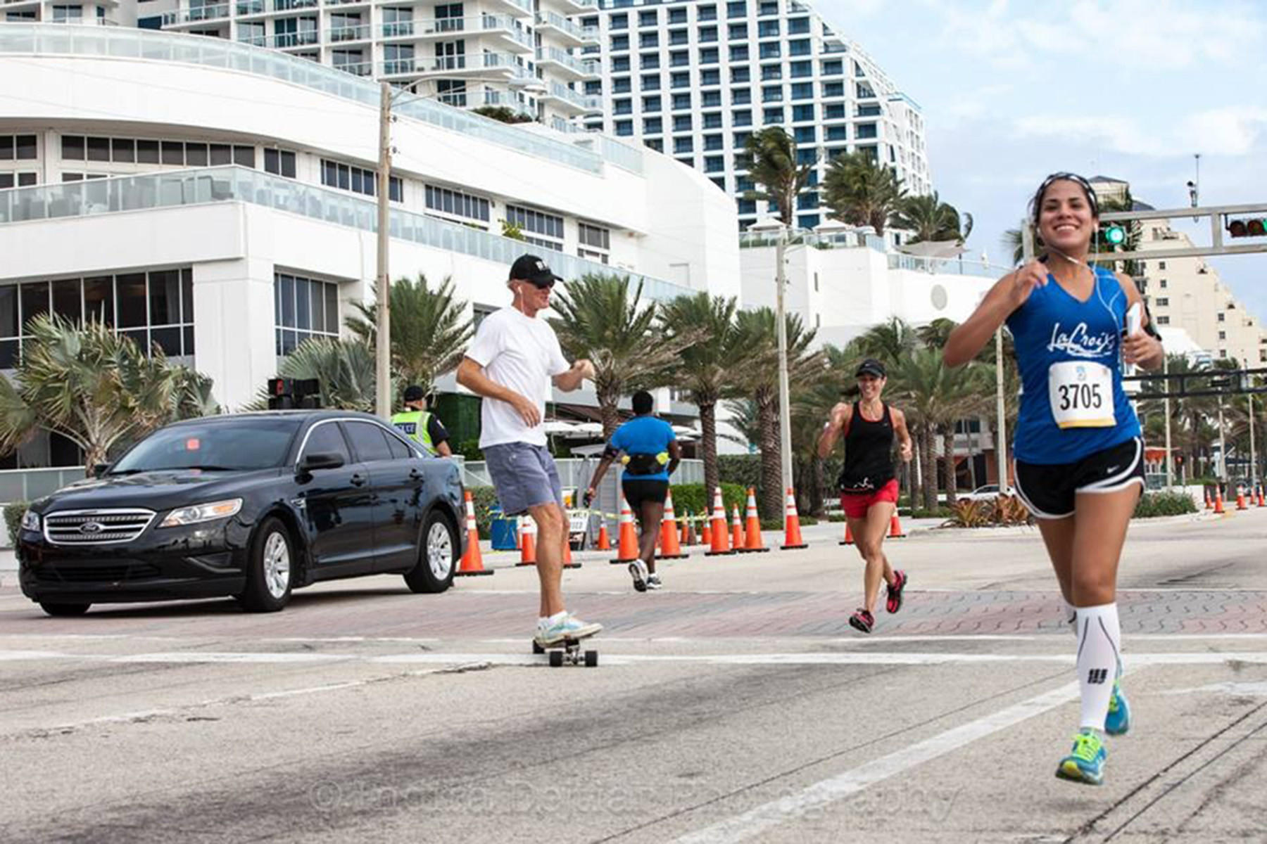 Tatiana Ortiz, right of Coral Springs, listens to nursing lectures while she runs. She is running the half marathon in the Miami Marathon Feb. 2. Handout photo provided by: Indira Dejtiar Photography
