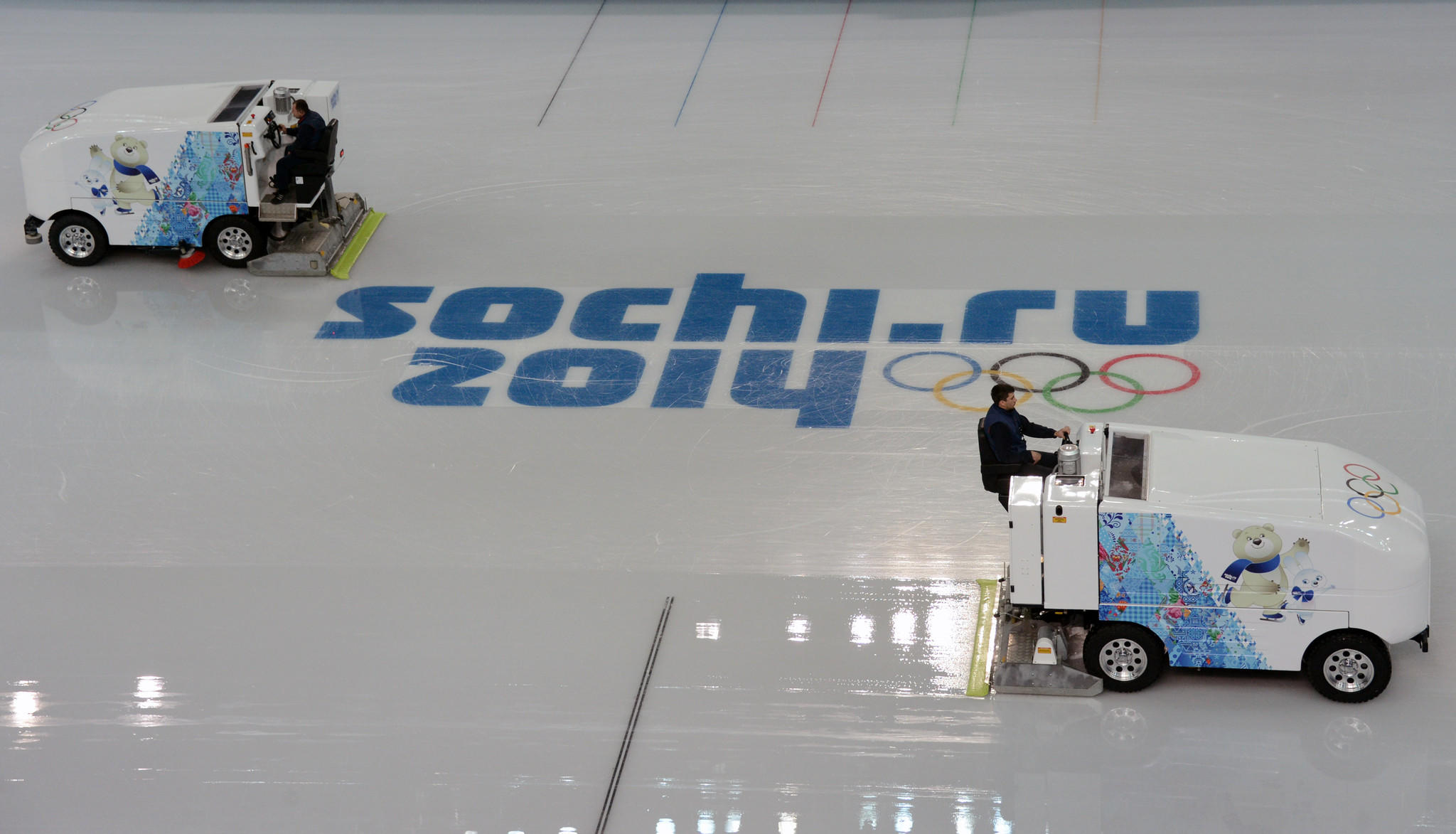 Zamboni machine drivers prepare the rink in Olympic Park prior to 2014 Sochi Winter Olympic Games at Iceberg Skating Palace.