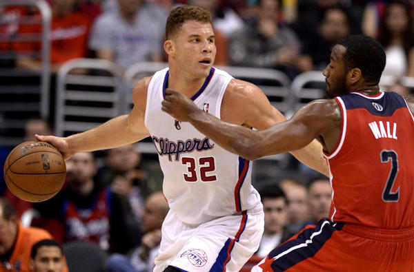 Clippers power forward Blake Griffin looks to drive against Wizards point guard John Wall during their game last week at Staples Center.