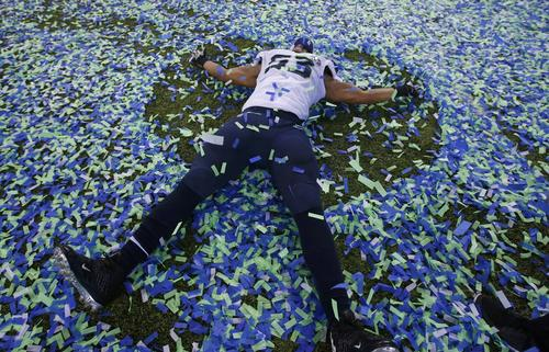 Super Bowl MVP Malcom Smith makes an angel in the confetti after his team defeated the Bronocs.