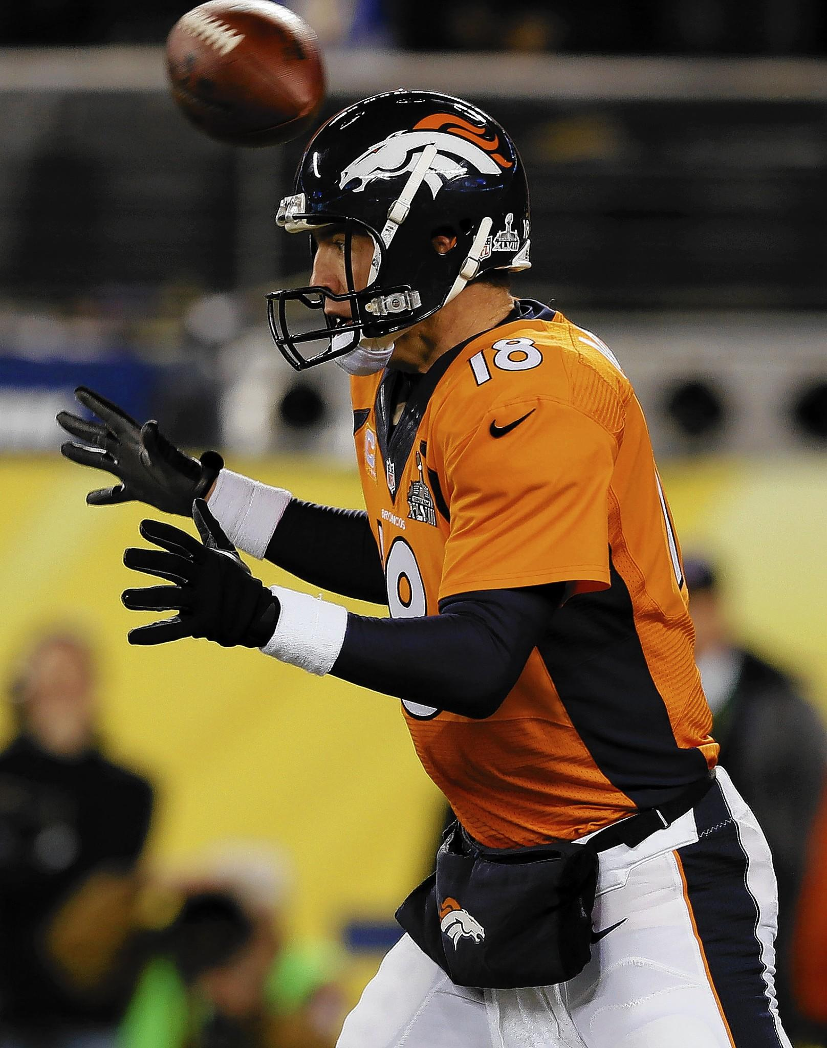 The ball flies over the head of Denver quarterback Peyton Manning in the first quarter. It was that kind of night for the Broncos.