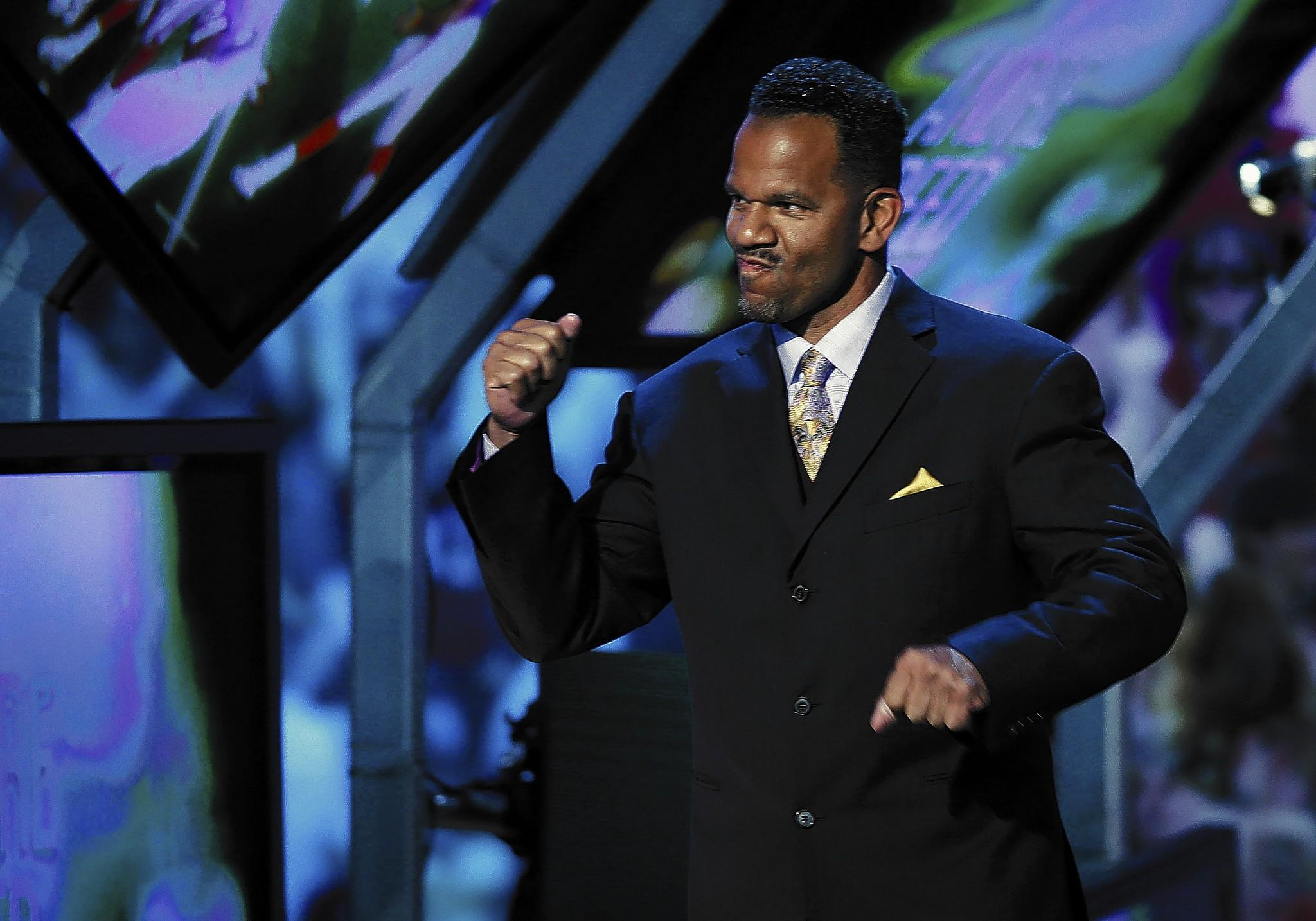 Former Dieruff High and Kutztown University star Andre Reed acknowledges the crowd as walks on stage during the NFL Honors award show in New York on Saturday night.