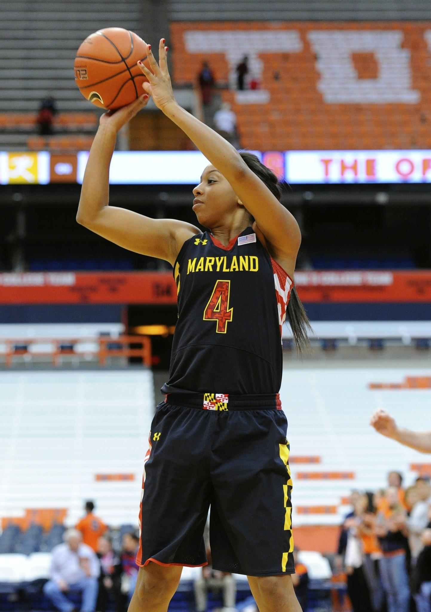 Feb 2, 2014; Syracuse, NY, USA; Maryland Terrapins guard Lexie Brown (4) takes a shot against the Syracuse Orange during the first half at the Carrier Dome. Maryland defeated Syracuse 89-64. Mandatory Credit: Rich Barnes-USA TODAY Sports