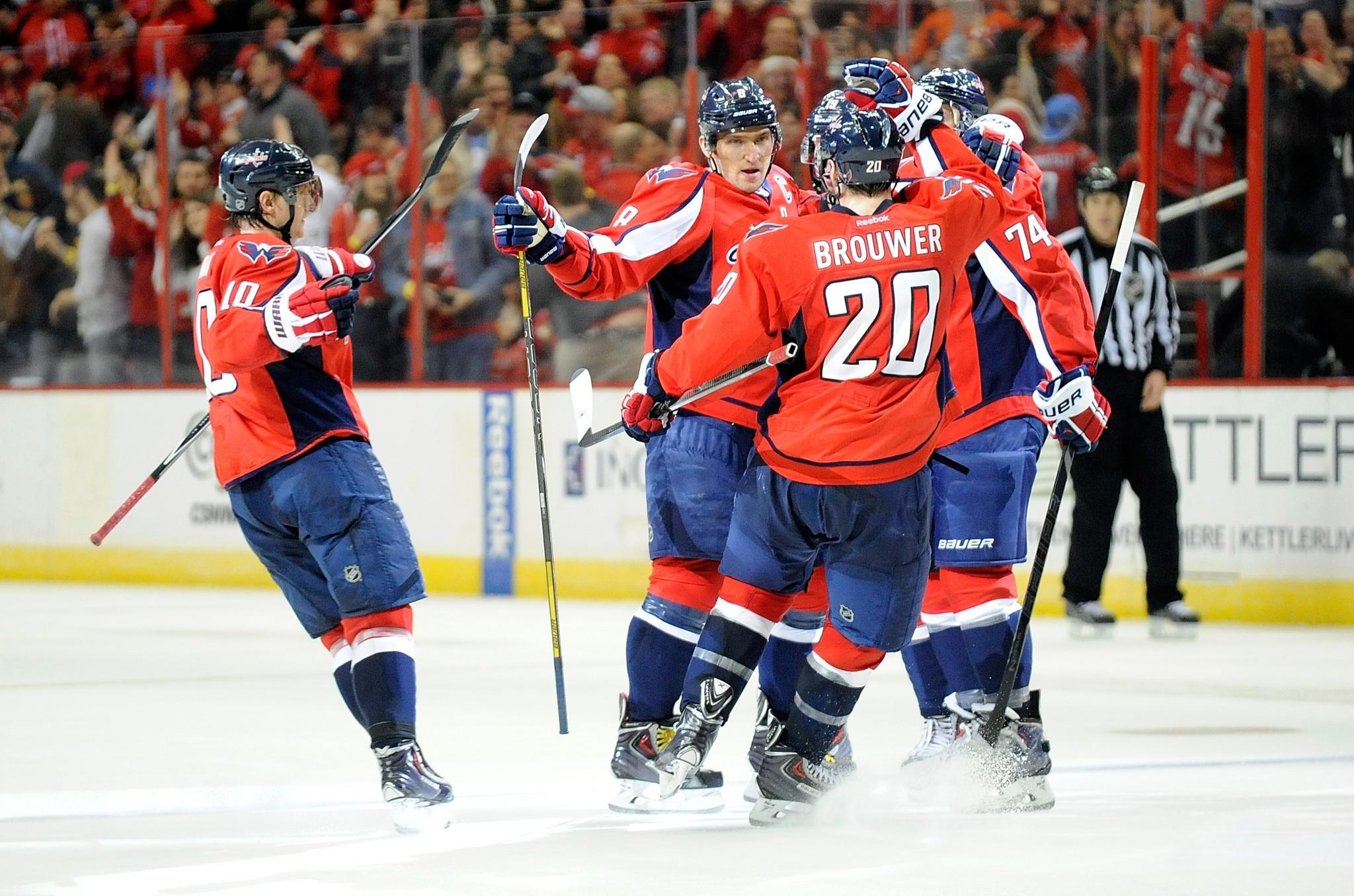 WASHINGTON, DC - FEBRUARY 02: Alex Ovechkin #8 of the Washington Capitals celebrates with teammates after scoring the game winning goal in overtime against the Detroit Red Wings at Verizon Center on February 2, 2014 in Washington, DC. Washinton won the game 6-5. (Photo by Greg Fiume/Getty Images) ORG XMIT: 181113810