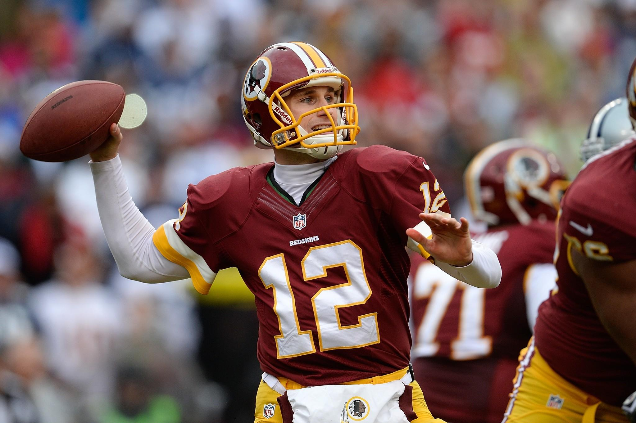 LANDOVER, MD - DECEMBER 22: Quarterback Kirk Cousins #12 of the Washington Redskins throws a pass in the first quarter during an NFL game against the Dallas Cowboys at FedExField on December 22, 2013 in Landover, Maryland. (Photo by Patrick McDermott/Getty Images) ORG XMIT: 187480847