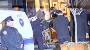 Philip Seymour Hoffman's body is carried out in a gurney outside his NYC apartment.