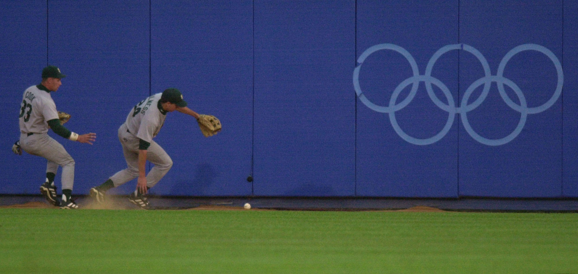 South African outfielders chase a hiy by Brad Wilkerson of the U.S. at the 2000 Olympics.