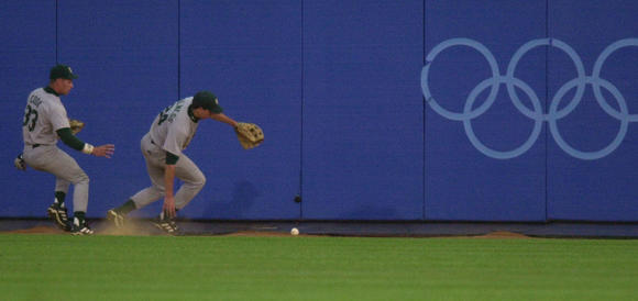 South African outfielders chase a hit by Brad Wilkerson of the U.S. at the 2000 Olympics.  (NuccioDi Nuzzo / Chicago Tribune)