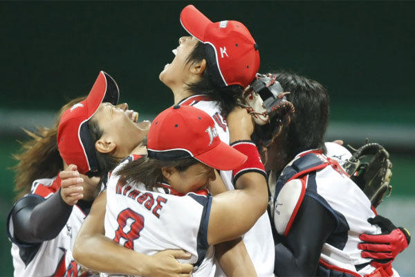 Japanese players celebrate a victory over the U.S. to win the gold medal in the 2008 Beijing Olympics.