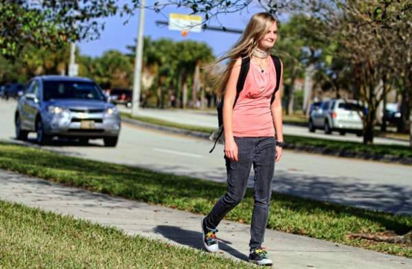 Felicia Mallory of Coral Springs, walks home from school. Mallory a junior at Coral Glades High school in Coral Springs, opted not to get her driver's license. Recent national studies are pointing to fewer teen drivers on the roads.