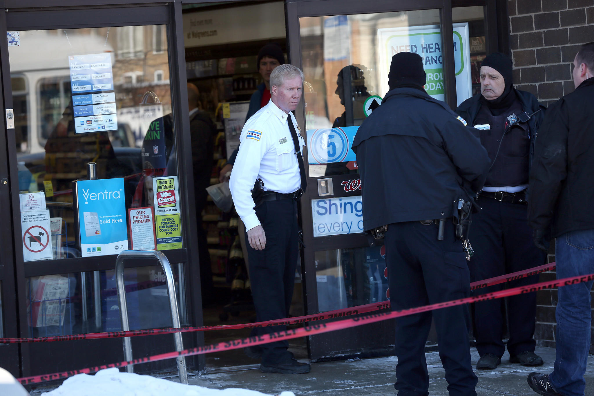 Police investigate a police-involved shooting at a Walgreen's store at Foster and Milwaukee Avenues.