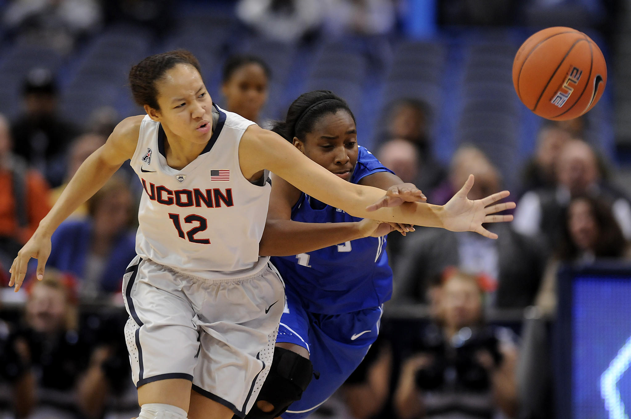 Hartford, CT 01/22/14 Connecticut Huskies guard Saniya Chong (12) and Memphis Lady Tigers guard Breigha Wilder-Cochran (1) battle for a loose ball during the first half at the XL Center in Hartford Wednesday night. UConn leads 39-23 at the half. Photo by JOHN WOIKE | woike@courant.com hc-uconn-women-memphis-0123