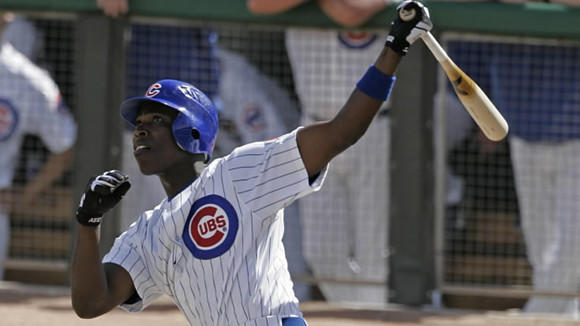 Alfonso Soriano hits a home run during the first inning of a spring training baseball game against the Oakland Athletics Wednesday, March 7, 2007, in Mesa, Ariz.
