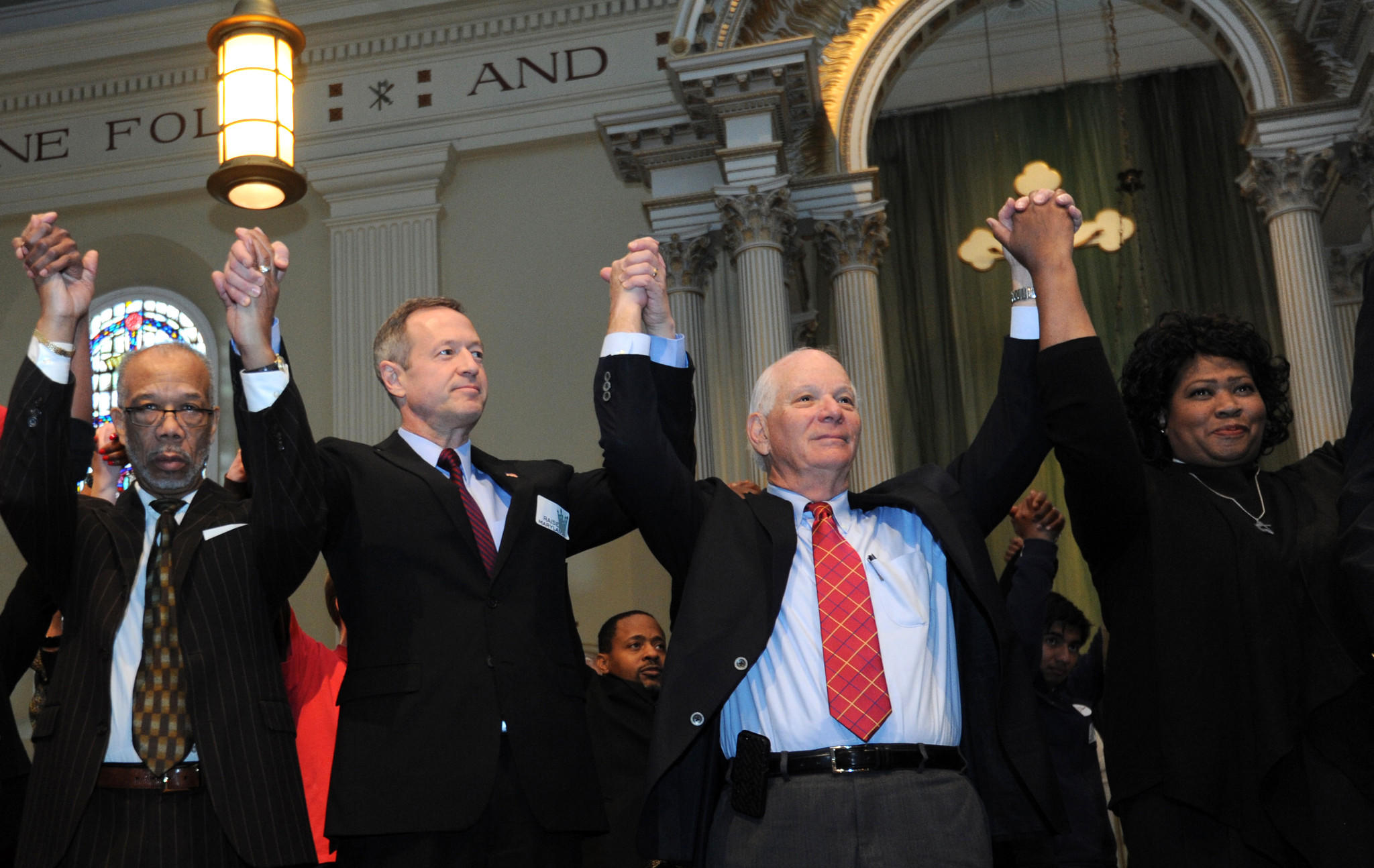 At St. Vincent de Paul, raising their arms in support of raising the minimum wage are from left: Rev. Dr. Harlie Walden Wilson, II, Israel Baptist Church; Gov. Martin O'Malley; Sen. Ben Cardin, and Rev. Dr. Carletta Allen, Asbury UMC (Annapolis).
