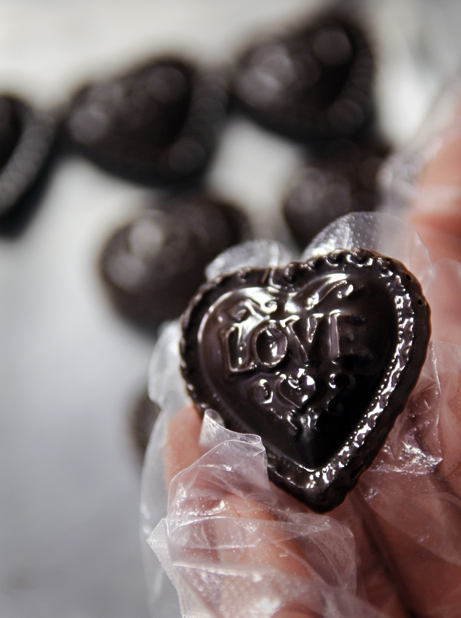 Tschudin Chocolates on Main Street in Middletown creates award-winning chocolates. In photo, some Valentine's Day-themed dark chocolate medallions are prepared for the big day.