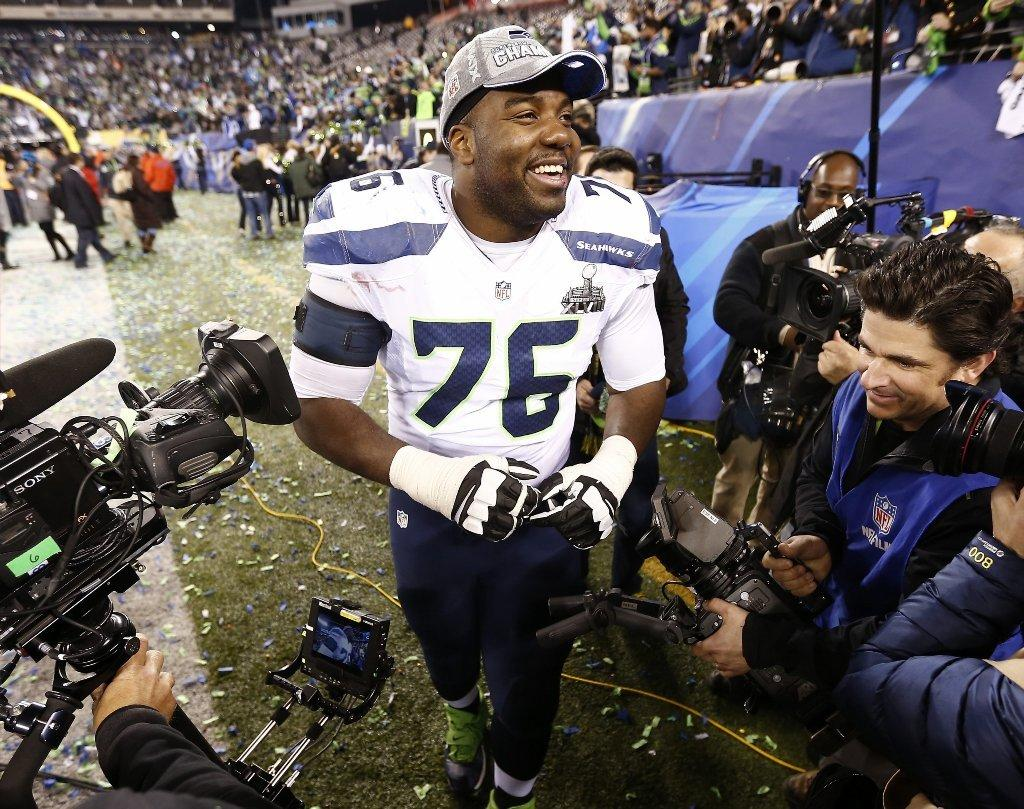 Seattle Seahawks tackle Russell Okung celebrates after the Seattle Seahawks defeated the Denver Broncos to win Super Bowl XLVIII Sunday. The game, telecast on Fox, drew record ratings.