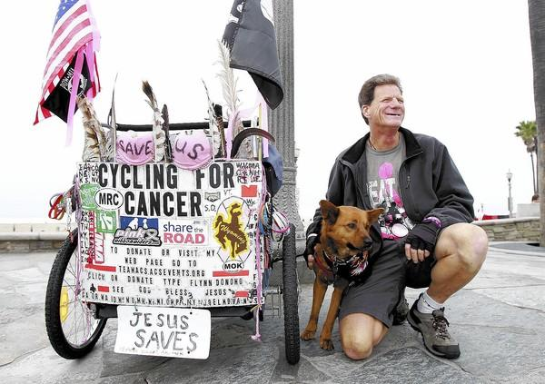 Flynn Donoho crossed America on a bike pulling a small trailer in an effort to raise money for the American Cancer Society.