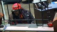 Man in 'Haters Gonna Hate' cap wanted in bank robbery