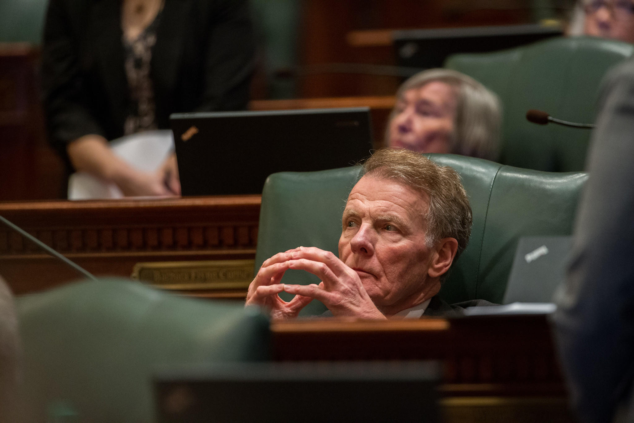 House Speaker Michael Madigan listens after introducing a bill to overhaul the state government worker pension system in Springfield on Dec. 3, 2013.