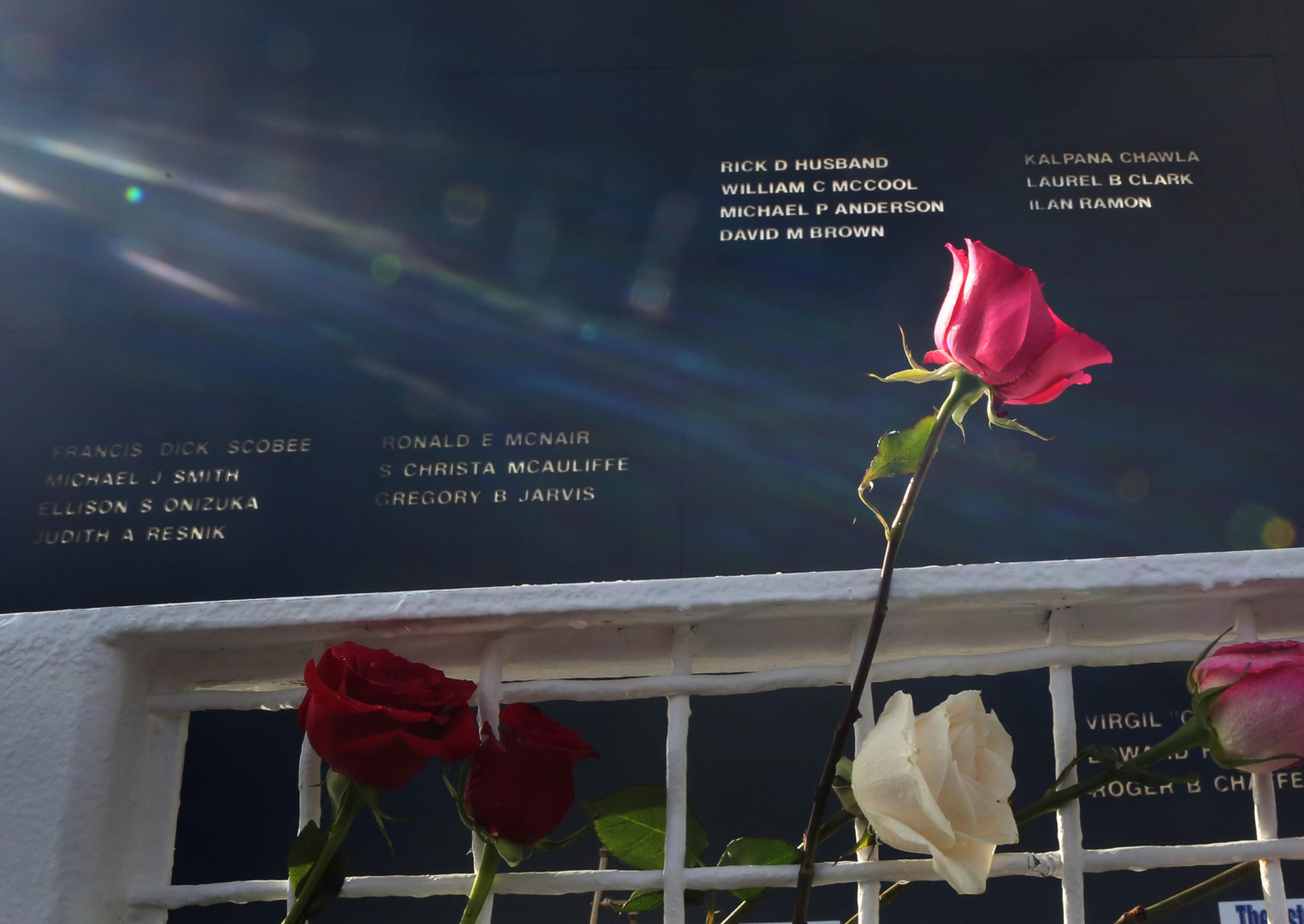 Flowers are left at Kennedy Space Center in memory of astronauts who died during service to the space program