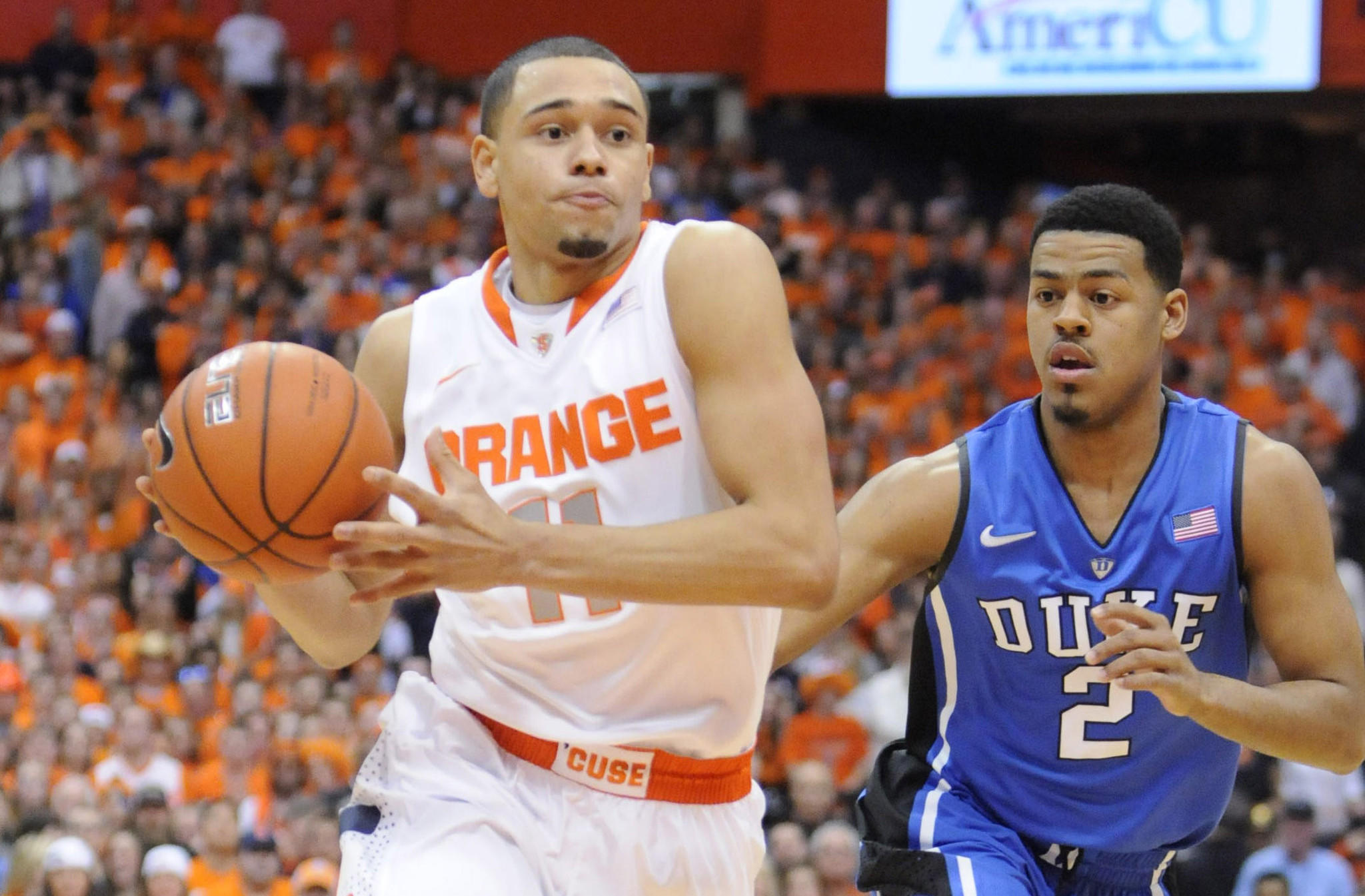 Syracuse's Tyler Ennis drives the ball past Duke's Quinn Cook during the first half.