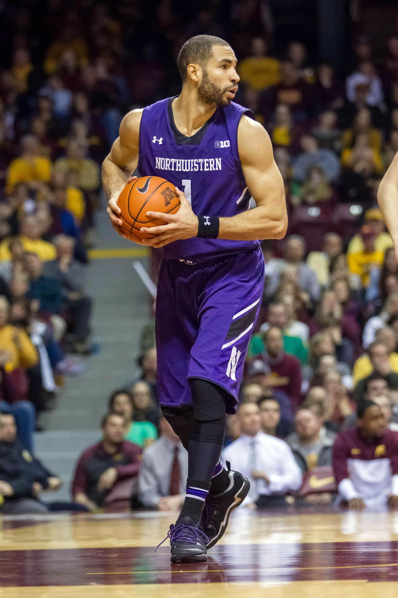 Northwestern's Drew Crawford rebounds in the second half against Minnesota.