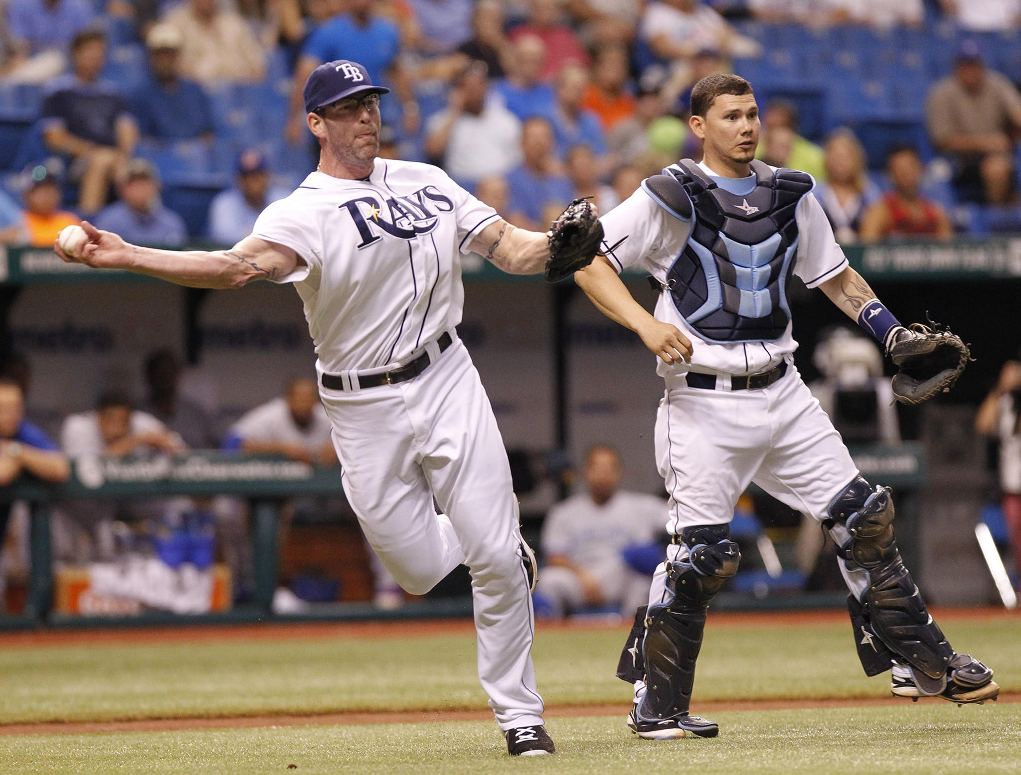 The Rays' Kyle Farnsworth throws out a runner on a bunt.