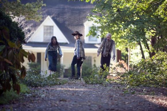 Carl (Chandler Riggs) leads walkers away from Rick.