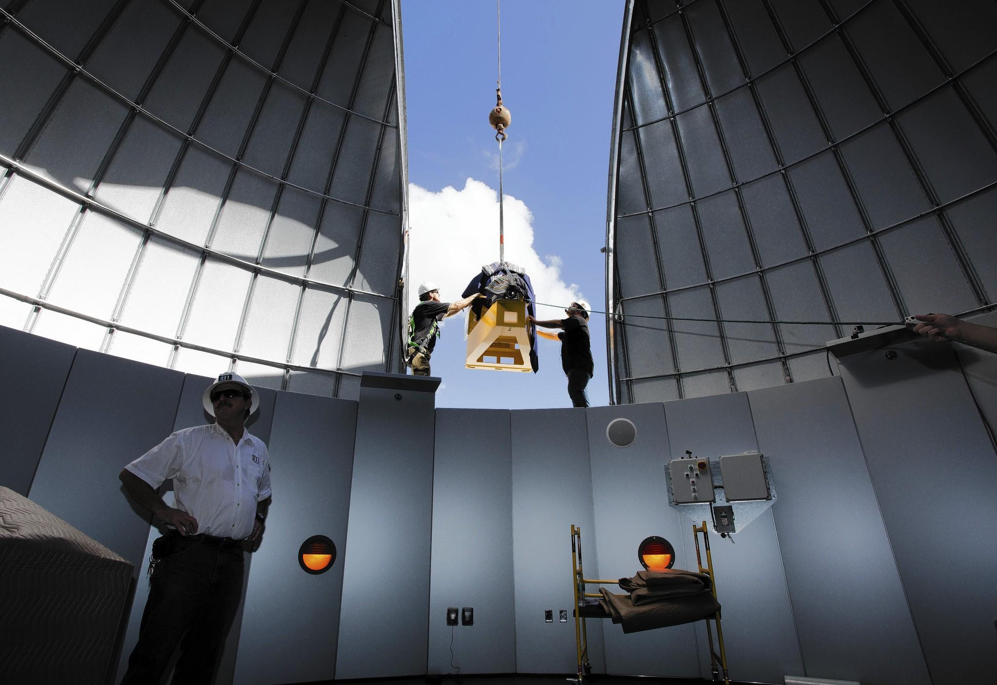 Workers install piece of $1 million telescope at Embry-Riddle in Daytona Beach
