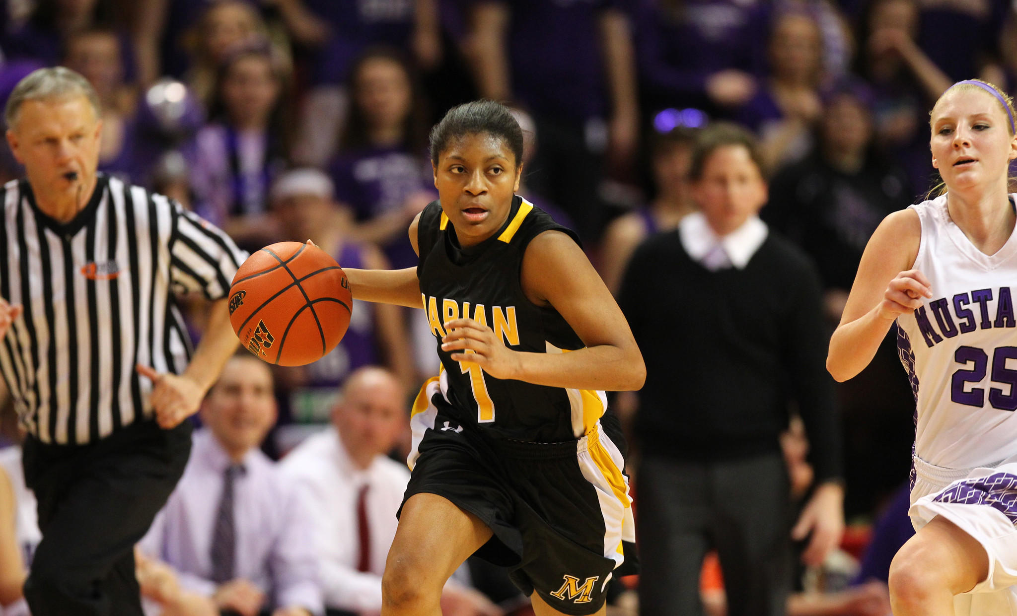 Marian Catholic's Teniya Page (1) moves the ball down the court as Rolling Meadows' Allie Kemph (25) trails behind during the Class 4A girls state basketball championship game on Saturday, March 2, 2013.