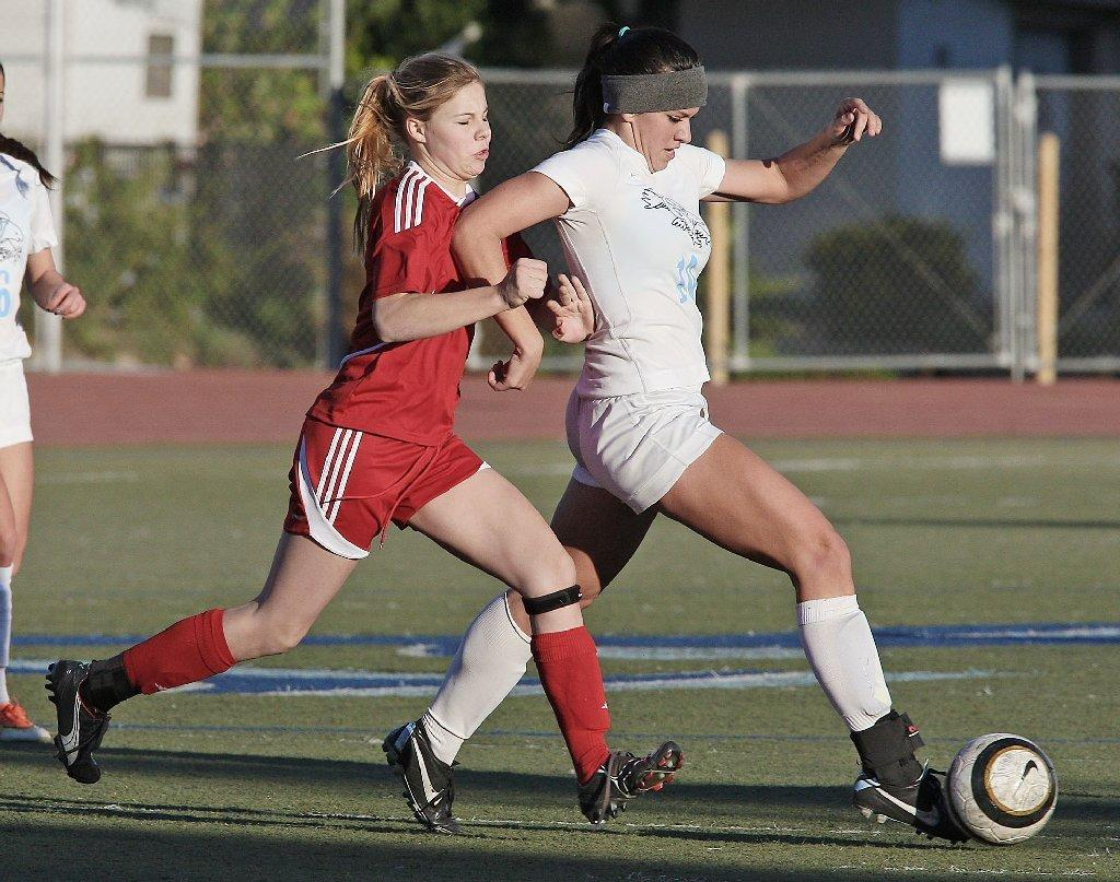 Courtney Ianello, right, and Crescenta Valley defeated Emma Pineiro and Burroughs on Monday.