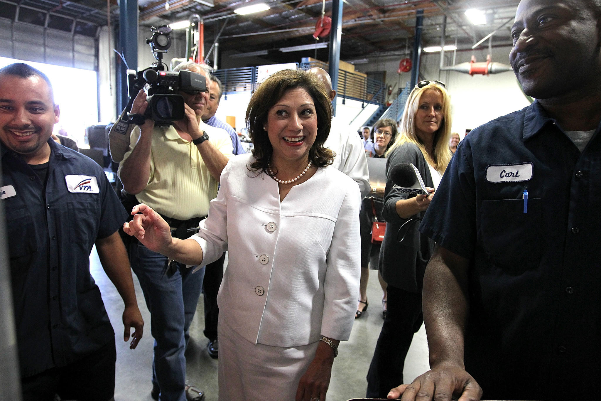 Then-U.S. Secretary of Labor Hilda Solis jokes with students in the Santa Clara Valley Transportation Authority hybrid technology training program in 2011.