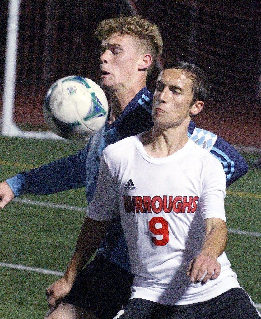 Crescenta Valley High's Daniel Eng (left) battles with Burroughs' Ashot Veisyan (right) for the ball in Pacific League boys' soccer action at Burroughs on Monday. The Indians won, 1-0. (Tim Berger/Staff Photographer)