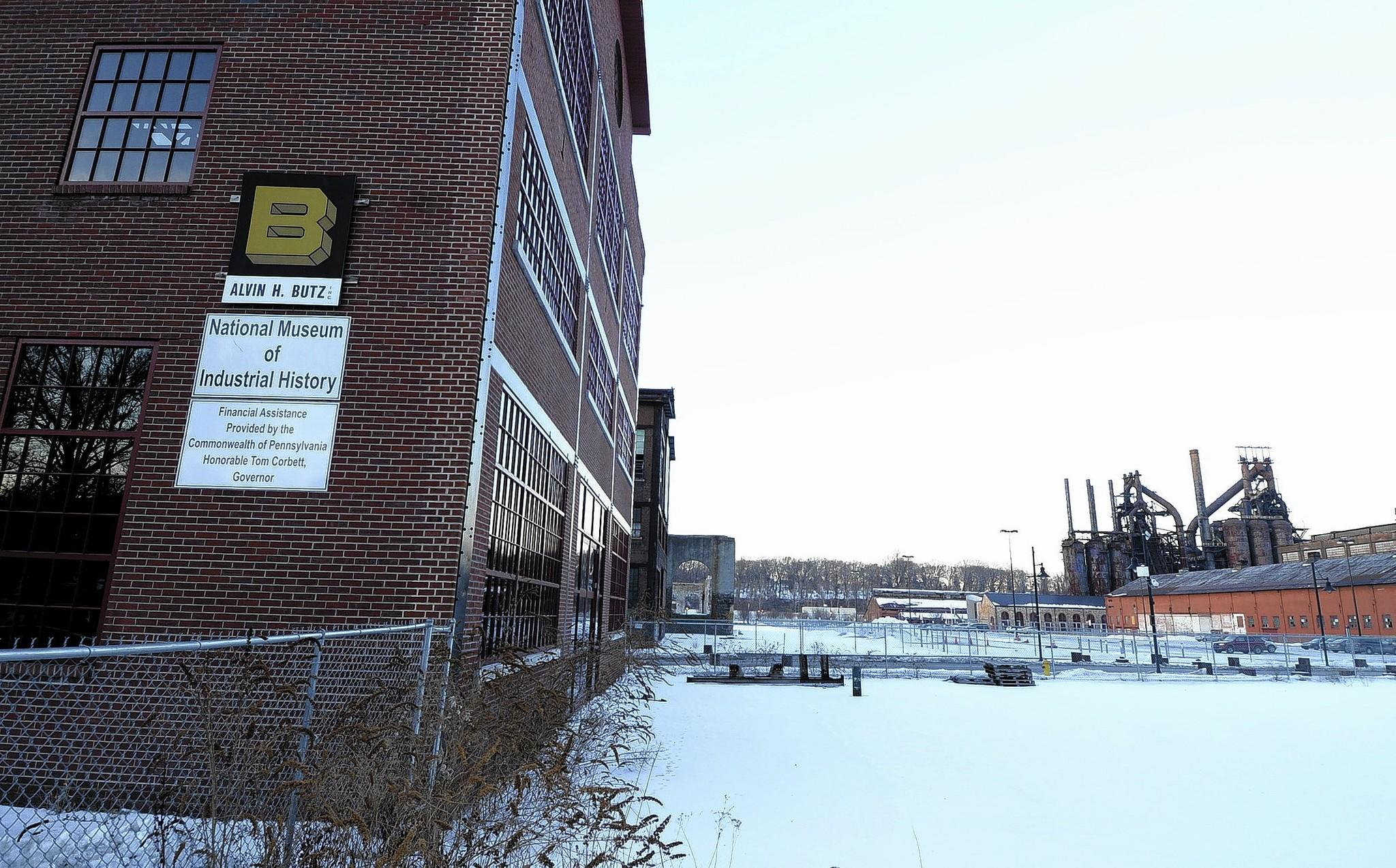 A Northampton County grand jury report concluded that the National Museum of Industrial History in Bethlehem was mismanaged for years. The museum's vacant building (left) is seen with old Bethlehem Steel buildings in the background.