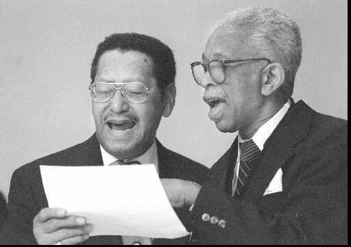 "For a 1995 celebration of African American History Month at Manchester Community College, music was provided by the Norman Macklin Quartet. Here, Norman Macklin, left, of Hartford, and Kenny Carter of Bloomfield join in ""Lift Every Voice and Sing."""