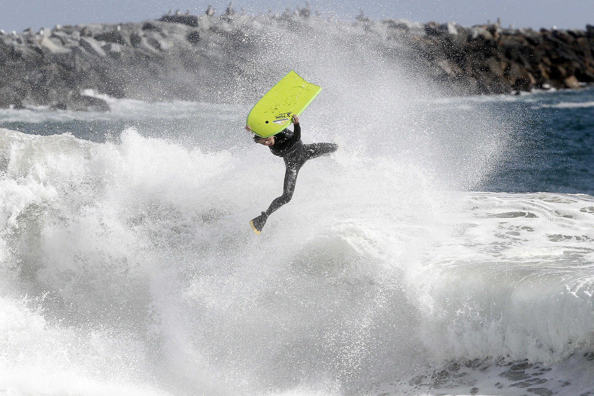 A bodyboarder loses control coming off a wave at The Wedge in Newport Beach.