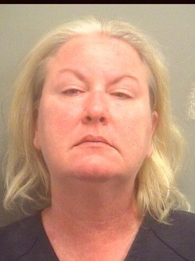 Heather Mary Watt, 47, is charged with aggravated assault with a weapon, armed burglary, burglary with a weapon and displaying a weapon during a felony.