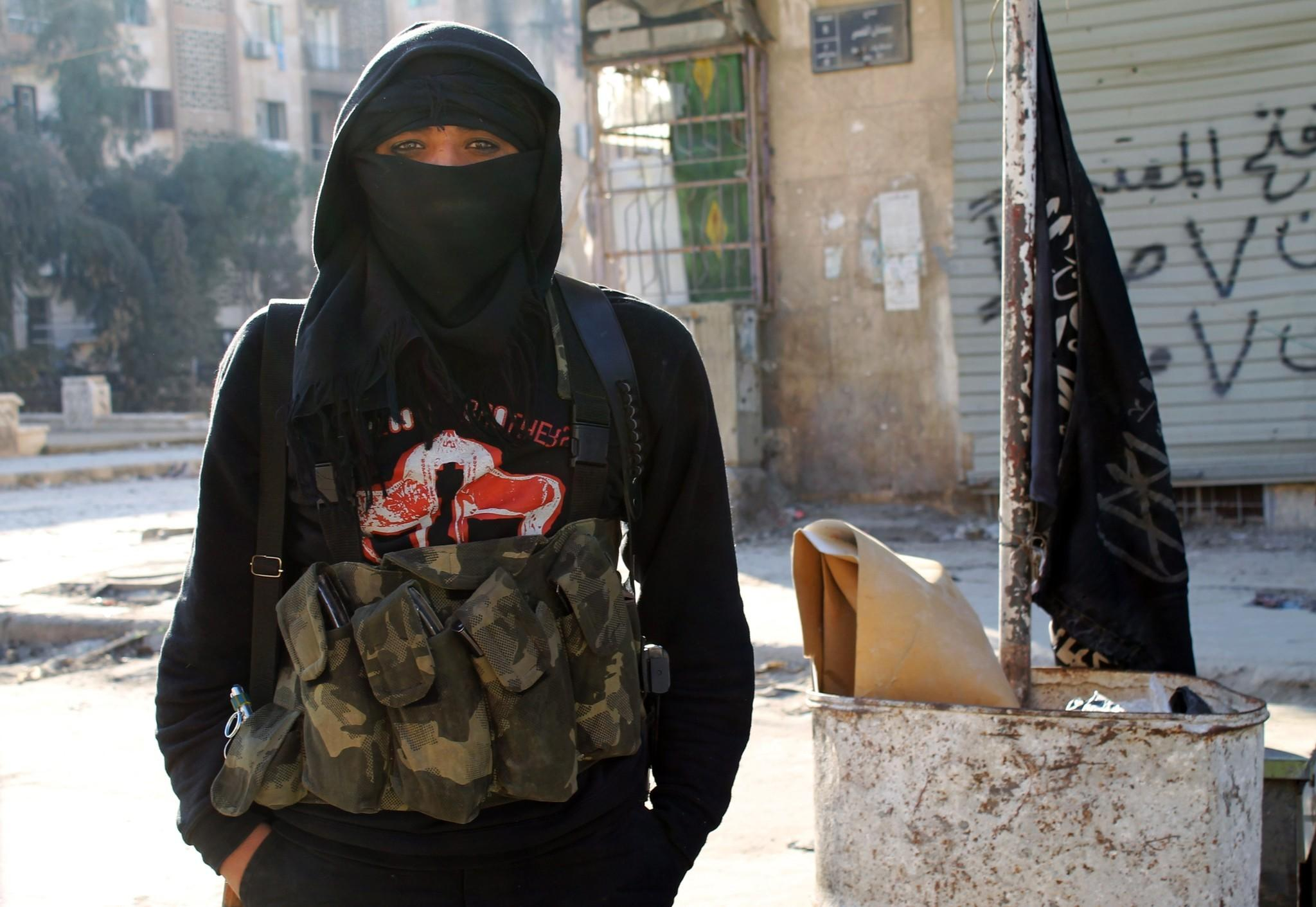 A member of the militant group Al Nusra Front stands in a street in the northern Syrian city of Aleppo last month.