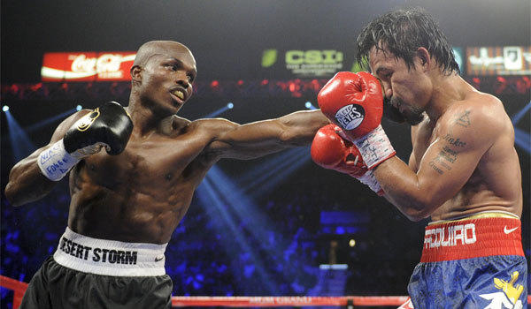 Timothy Bradley, left, lands a punch against Manny Pacquiao during their June 2012 WBO welterweight title fight in Las Vegas. Bradley won an unpopular split-decision, but he's looking for something more decisive in the rematch.
