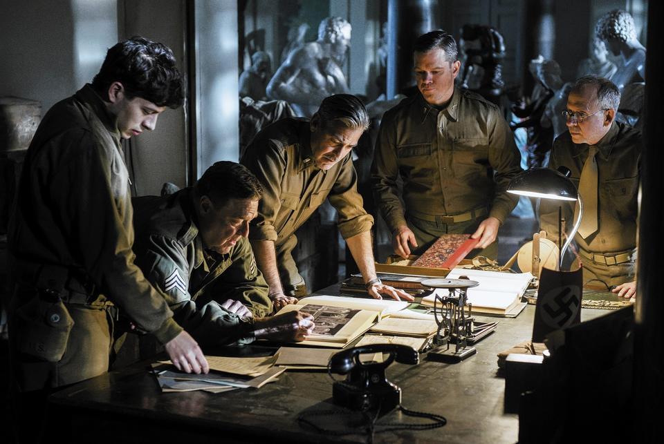 "George Clooney, Matt Damon, John Goodman and Bob Balaban in ""The Monuments Men."""