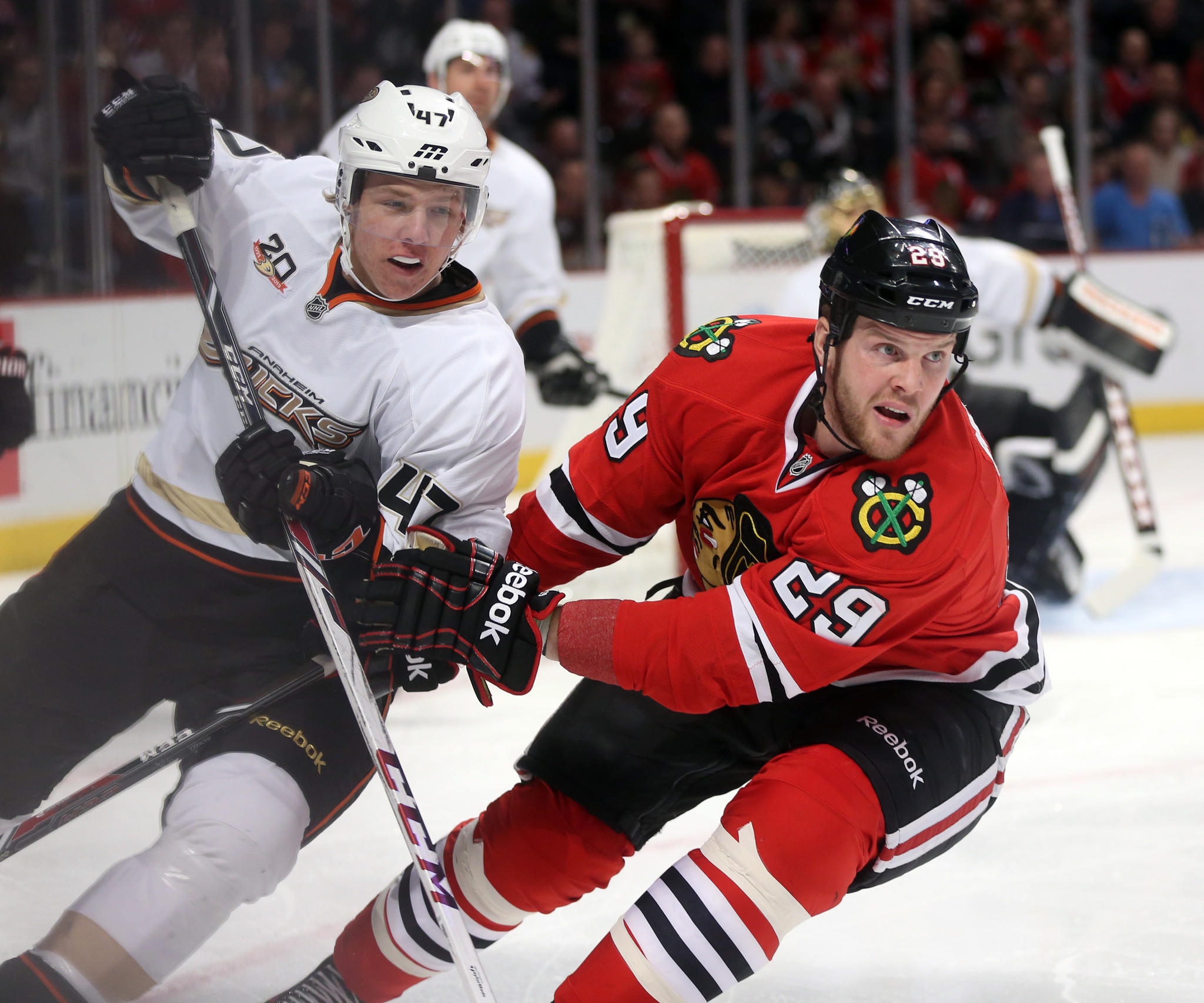 Blackhawks left wing Bryan Bickell skates against Ducks defenseman Hampus Lindholm in the first period.