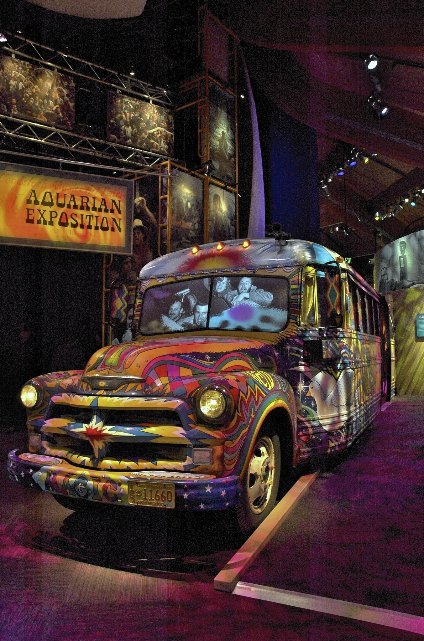 A psychedelic bus at the Museum of Bethel Woods serves as a video venue, showing footage of the Woodstock music festival inside.