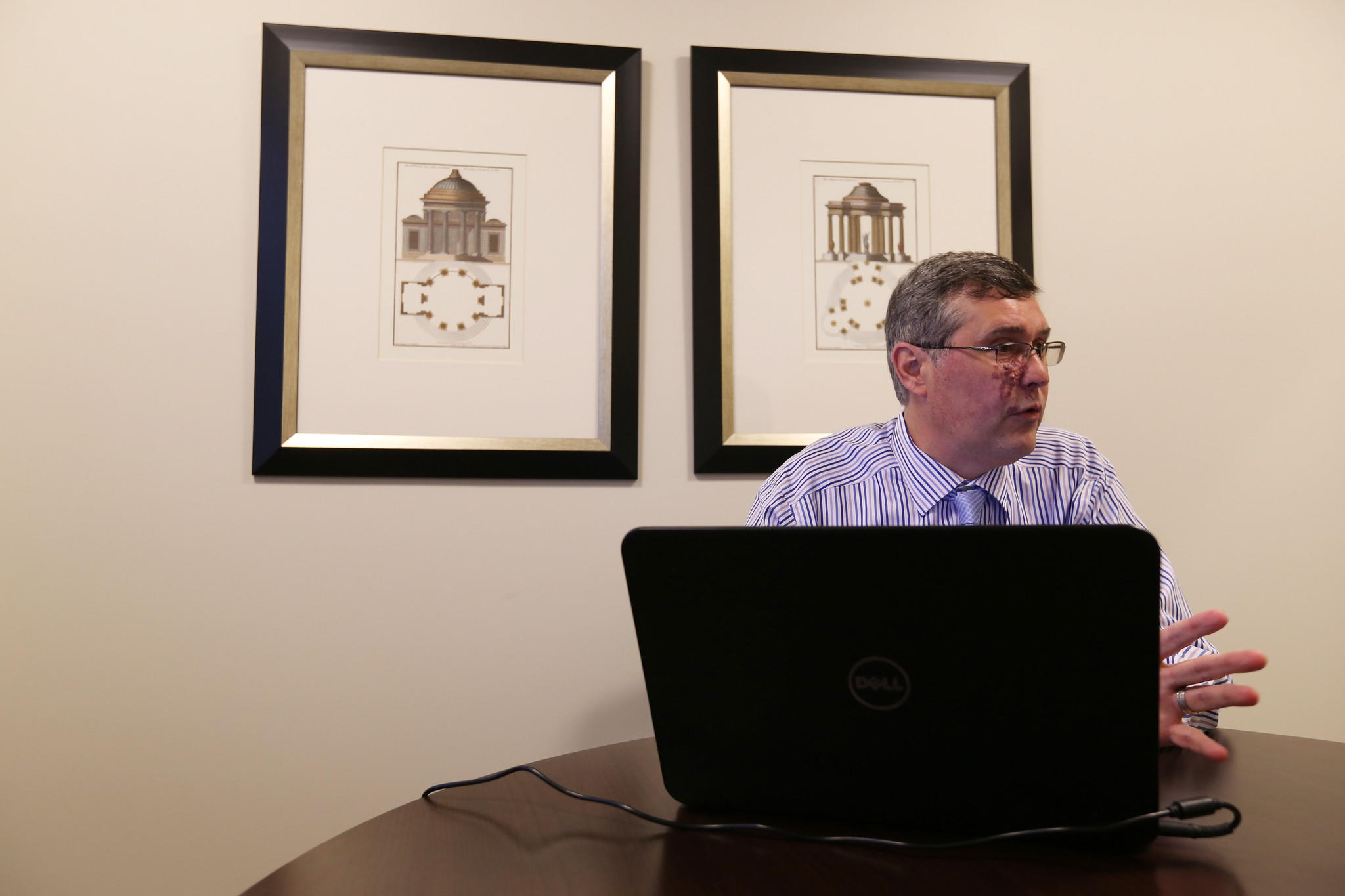 Tom Hodgson, a credit counselor talks with a client at his Winter Park office, on Wednesday, January 29, 2014.
