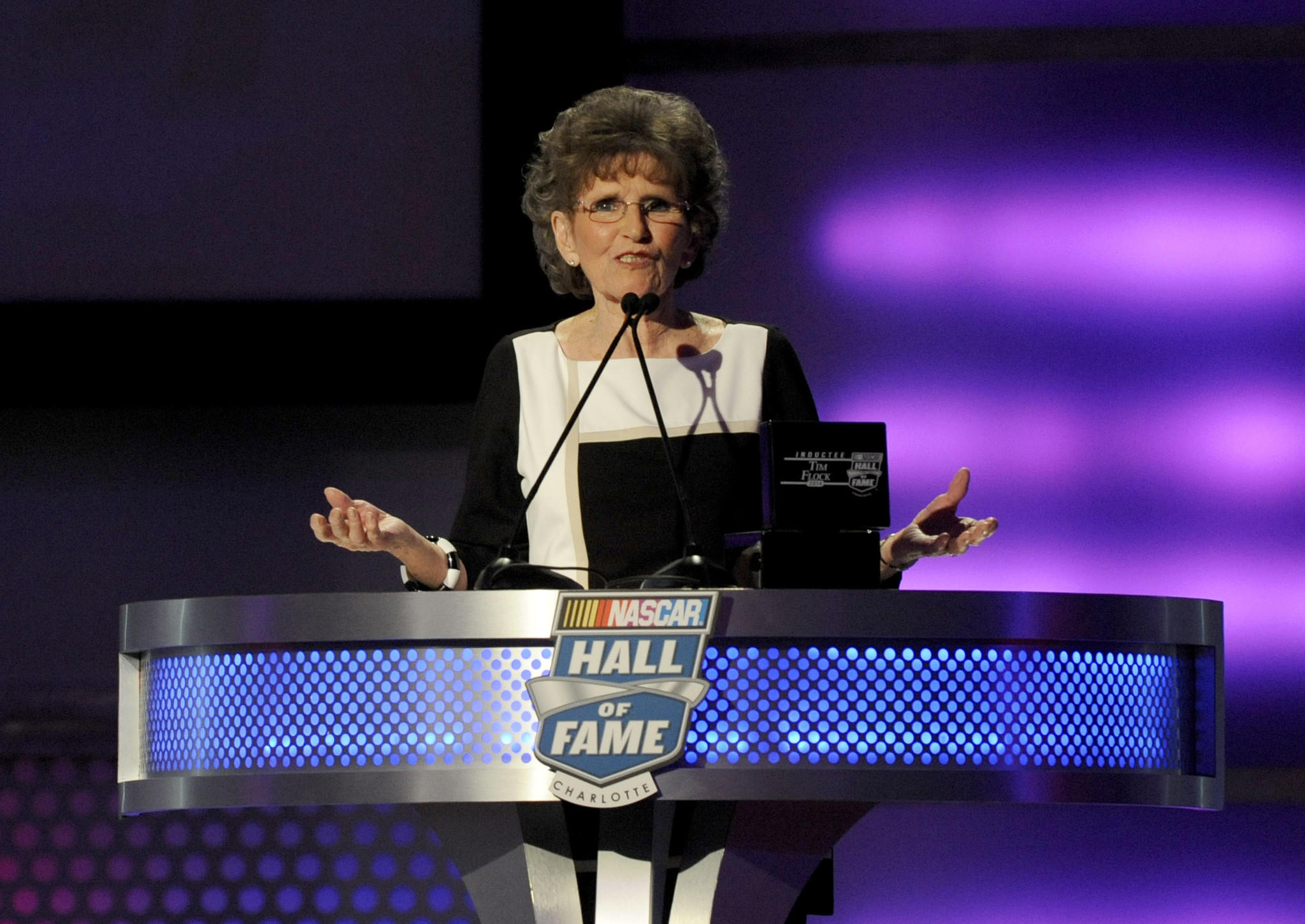 Francis Flock, widow of NASCAR Sprint Cup Series driver Tim Flock, makes a speech on behalf of her husband after he was inducted to the Hall of Fame during the NASCAR hall of fame induction ceremony at NASCAR Hall of Fame.