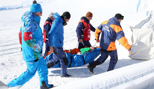 Snowboarder Marika Enne of Finaldn is carried off on a stretcher after a crash landing on the final jump of the slopestyle course at the Rosa Khutor Extreme Park prior to the Sochi 2014 Winter Olympics.