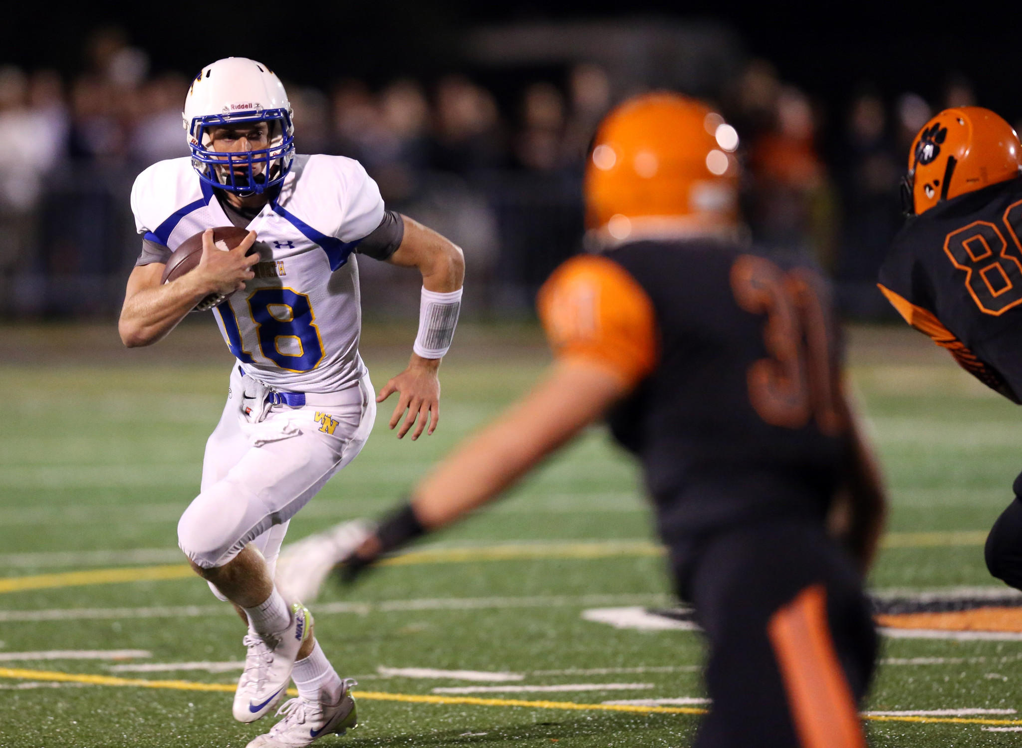 Wheaton North quarterback Clayton Thorson (18) rushes against Wheaton Warrenville South.