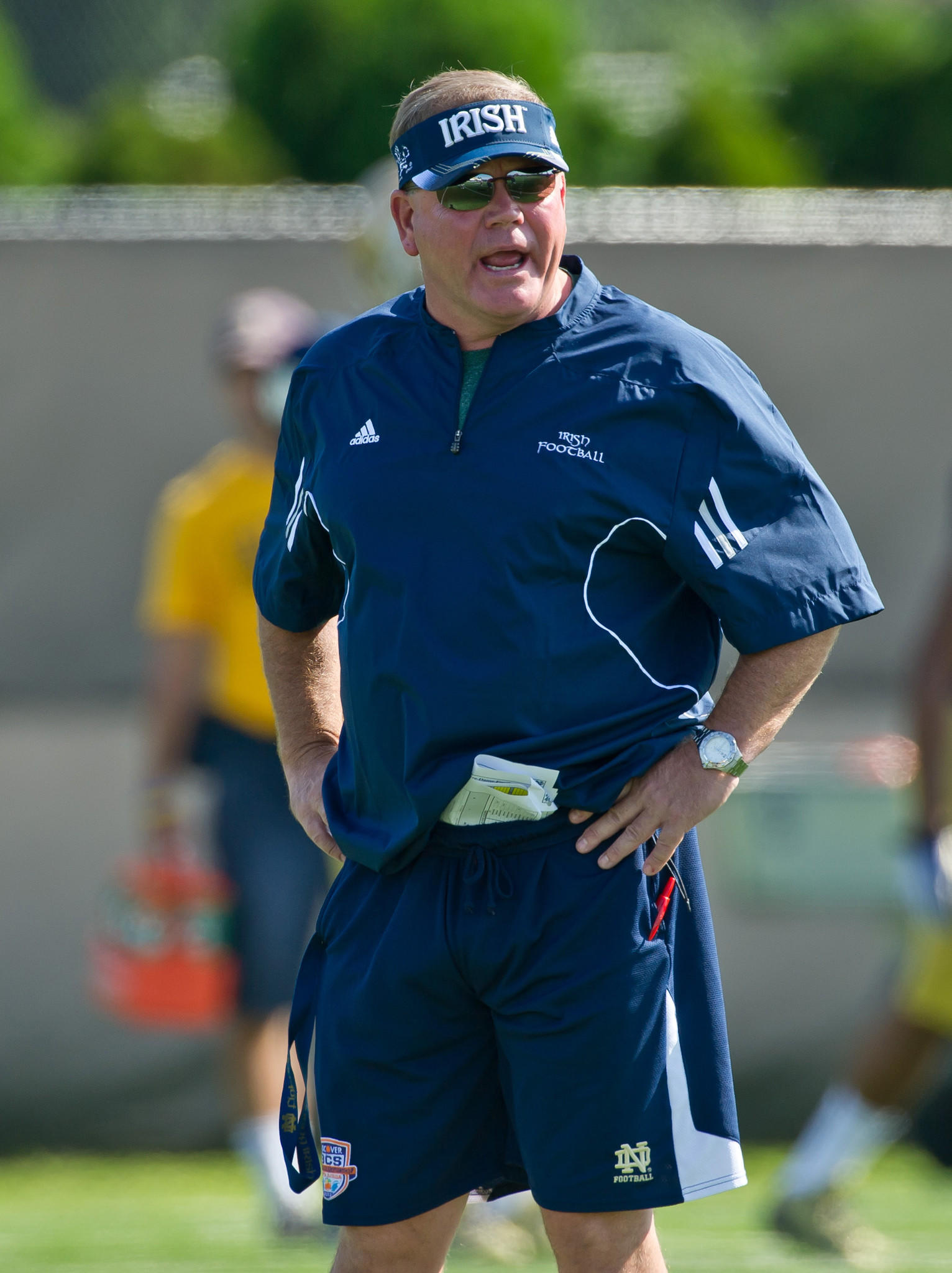 Notre Dame coach Brian Kelly yells to his players during practice.