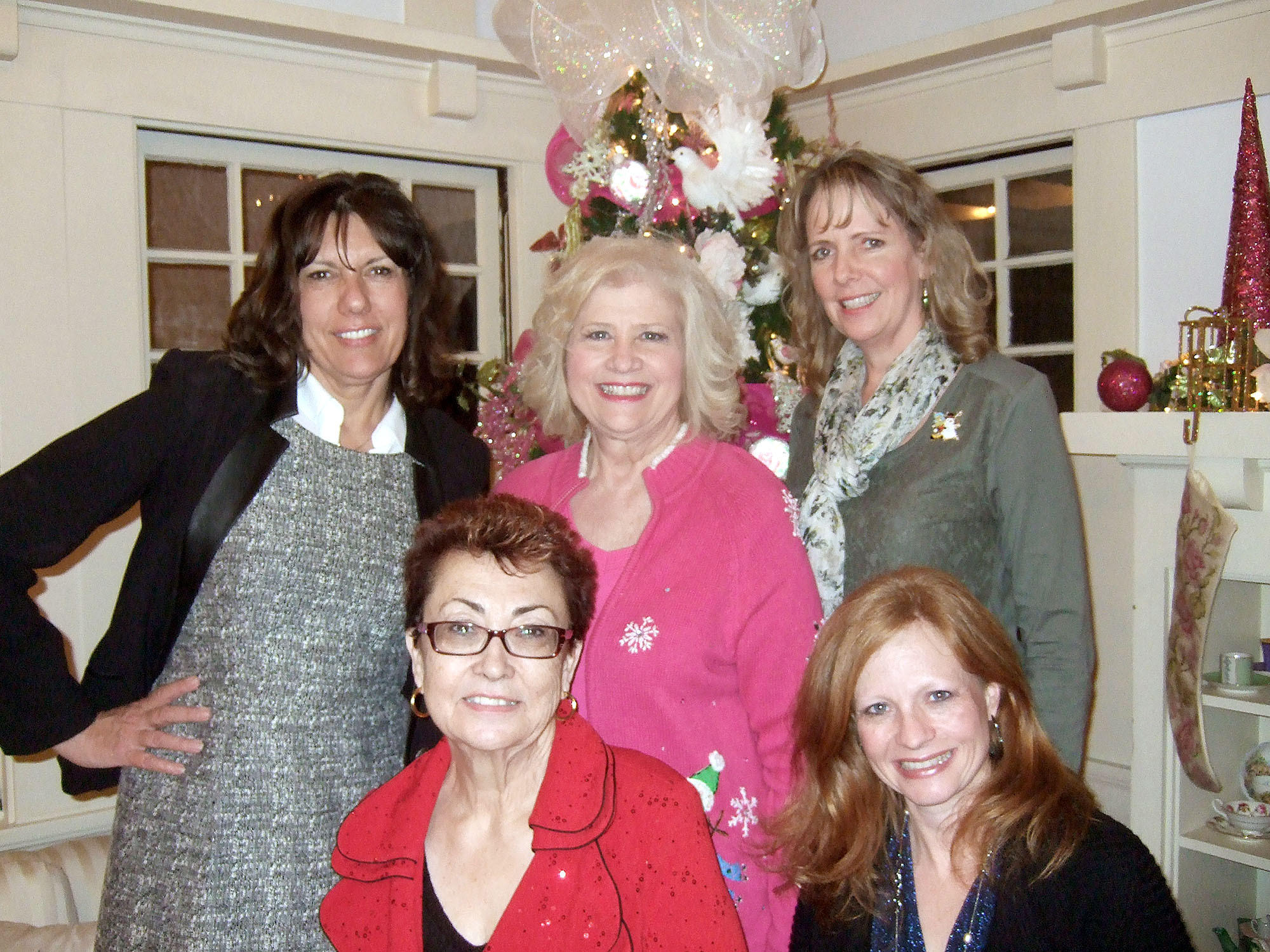 Members of the Glendale Area Panhellenic, front row from left, Janis Rosebrook and Julie Weller; and back row from left, Kim Westhoff, Deb Ann Orfalea and Rondi Redmann, at a recent holiday party.